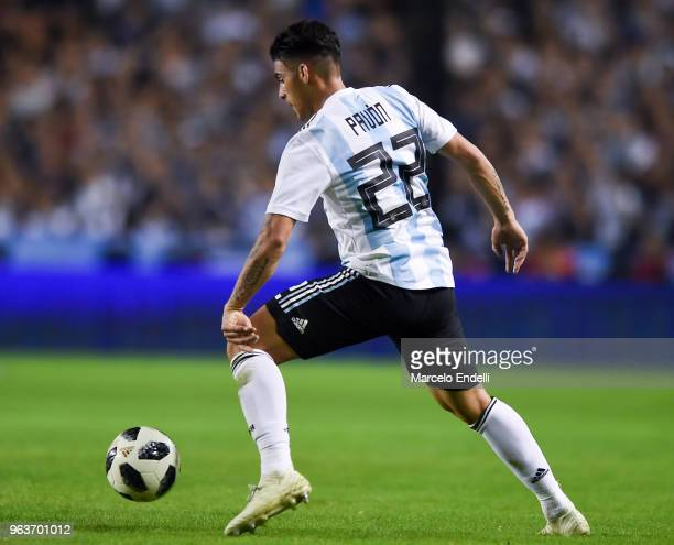 Cristian Pavon of Argentina drives the ball during an international friendly match between Argentina and Haiti at Alberto J Armando Stadium on May 29...