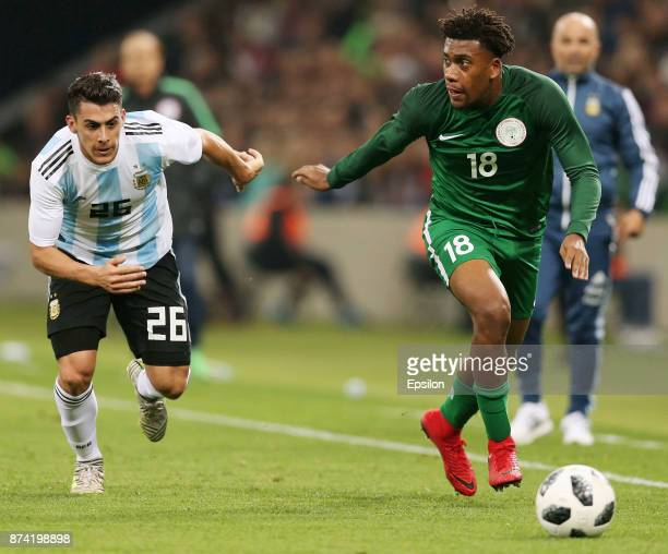 Cristian Pavon of Argentina fights for the ball with Alex Iwobi of Nigeria during an international friendly match between Argentina and Nigeria at...