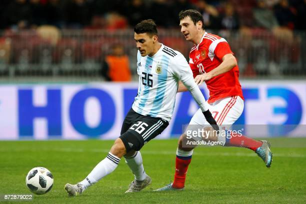 Cristian Pavon of Argentina in action against Alan Dzagoev of Russia during the international friendly match between Russia and Argentina at BSA OC...
