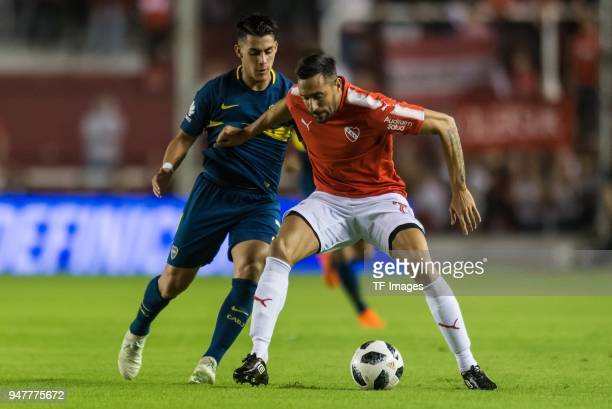 Cristian Pavon of Boca Juniors and Jonas Gutierrez of Independiente battle for the ball during a match between Independiente and Boca Juniors as part...