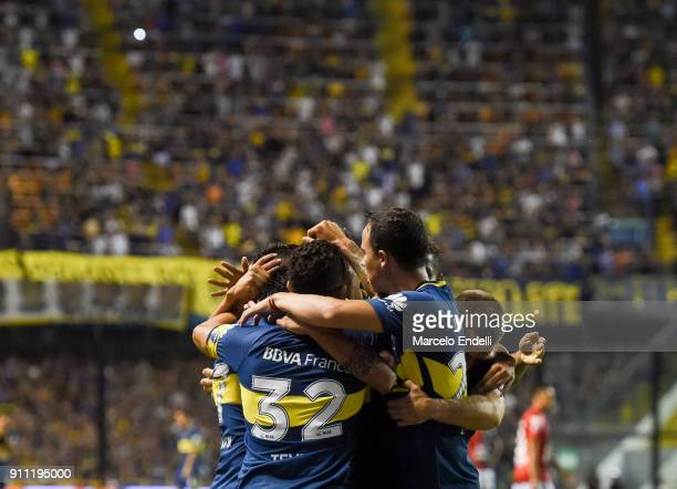 Cristian Pavon of Boca Juniors celebrates with teammates after scoring the first goal of his team during a match between Boca Juniors and Colon as...