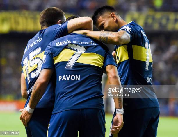 Cristian Pavon of Boca Juniors celebrates with teammates Nahitan Nandez and Walter Bou after scoring the first goal of his team during a match...
