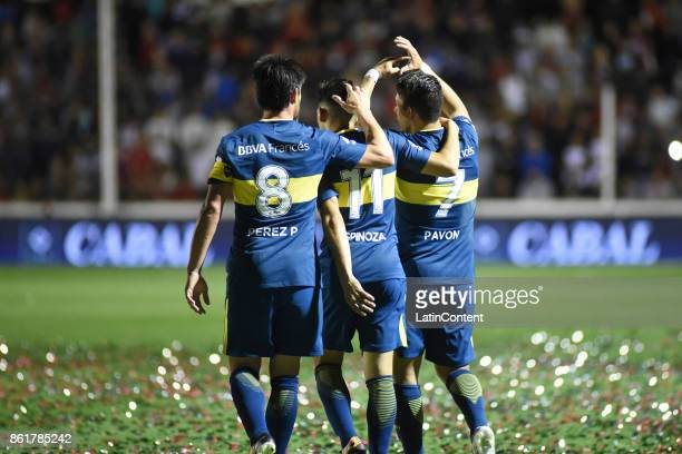 Cristian Pavon of Boca Juniors celebrates with teammates Pablo Perez and Cristian Espinoza after scoring the first goal of his team during a match...