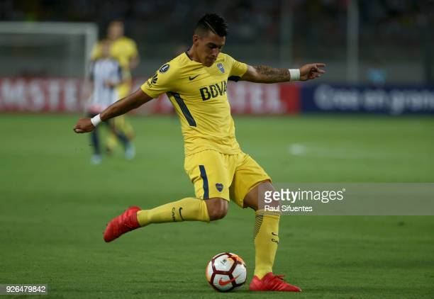 Cristian Pavon of Boca Juniors drives the ball during a groups stage match between Alianza Lima and Boca Juniors as part of Copa Conmebol...