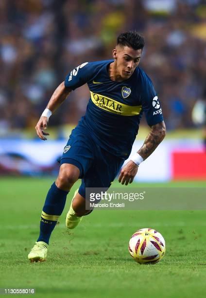 Cristian Pavon of Boca Juniors drives the ball during a match between Boca Juniors and Lanus as part of Superliga 2018/19 at Estadio Alberto J...