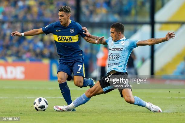 Cristian Pavon of Boca Juniors fights for the ball with Adrian Arregui of Temperley during a match between Boca Juniors and Temperley as part of the...