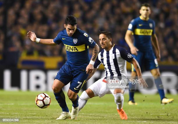 Cristian Pavon of Boca Juniors fights for the ball with Alejandro Hohberg of Alianza Lima during a match between Boca Juniors and Alianza Lima at...