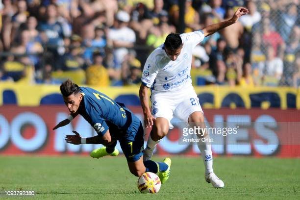 Cristian Pavon of Boca Juniors fights for the ball with Fabrizio Angileri of Godoy Cruz during a match between Boca Juniors and Godoy Cruz as part of...