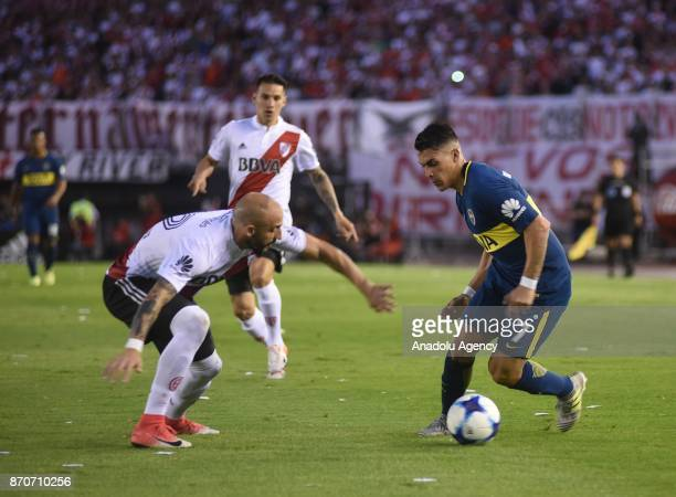 Cristian Pavon of Boca Juniors fights for the ball with Javier Pinola of River Plate during the match for the eighth date of the Argentine Soccer...