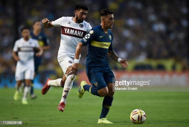 Cristian Pavon of Boca Juniors fights for the ball with Marcelino Moreno of Lanus during a match between Boca Juniors and Lanus as part of Superliga...
