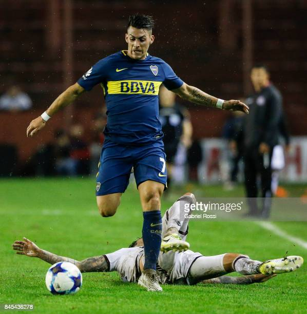 Cristian Pavon of Boca Juniors fights for the ball with Roman Martinez of Lanus during a match between Lanus and Boca Juniors as part of the...