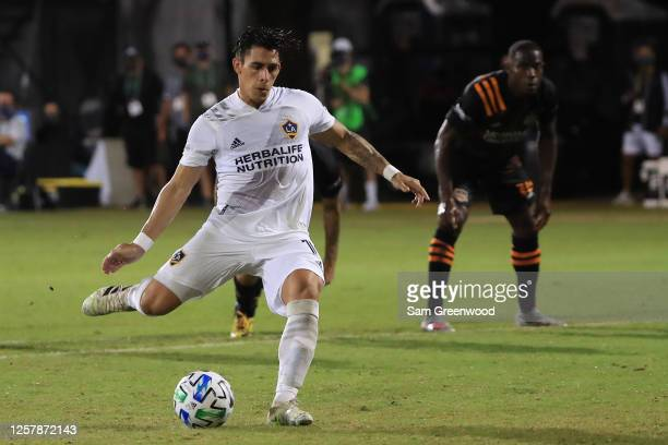 Cristian Pavon of Los Angeles Galaxy makes a penalty kick to score the first goal of his team during a match against Houston Dynamo as part of group...
