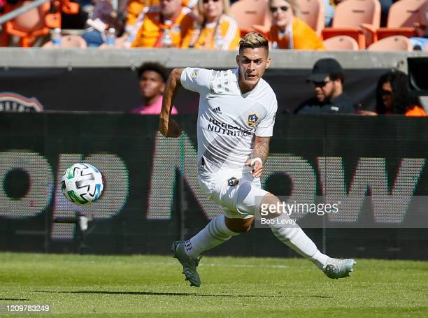 Cristian Pavon of Los Angeles Galaxy runs down the ball before he scores against the Houston Dynamo during the first half at BBVA Stadium on February...