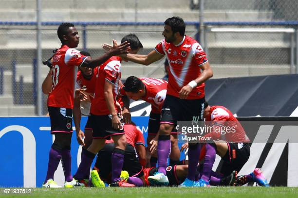 Cristian Pellerano and Jefferson Murillo of Veracruz celebrate the opening goal scored by Leandro Velazquez of Veracruz during the 15th round match...