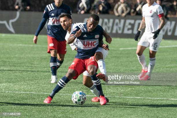 Cristian Penilla of New England Revolution and Jonathan Bornstein of Chicago Fire battle for the ball during a game between Chicago Fire and New...