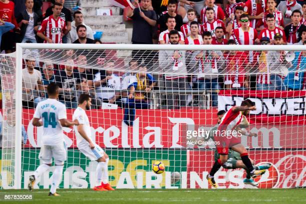 Cristian 'Portu' of Girona FC scores his team's second goal during the La Liga match between Girona and Real Madrid at Estadi de Montilivi on October...
