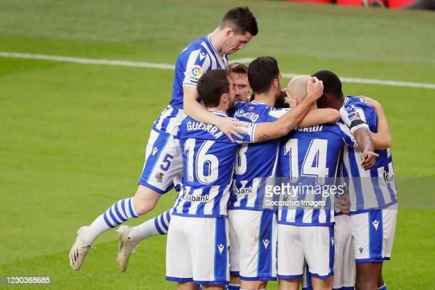 Cristian Portu of Real Sociedad Celebrates 0-1 with teammates during the La Liga Santander match between Athletic de Bilbao v Real Sociedad at the...