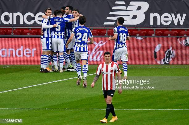 Cristian Portu of Real Sociedad celebrates with his team after scoring the opening goal during the La Liga Santander match between Athletic Club and...