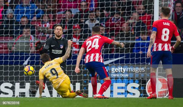 Cristian ÔPortu' Portugues of Gerona beats Jan Oblak of Atletico de Madrid to score his team's opening goal during the La Liga match between Atletico...
