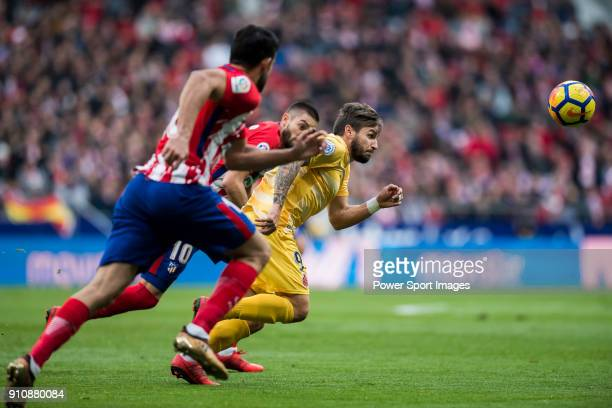 Cristian Portugues Manzanera of Girona FC fights for the ball with Yannick Ferreira Carrasco of Atletico de Madrid during the La Liga 201718 match...