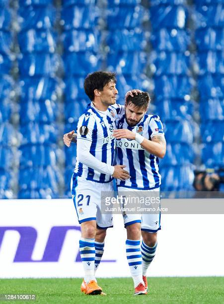 Cristian Portugues of Real Sociedad celebrates with his teammate David Silva of Real Sociedad after scoring the opening goal during the UEFA Europa...