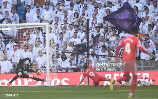 Cristian Portugues ''Portu'' of Girona beats Marcelo and Thibaut Courtois of Real Madrid to scores his team's second goal during the La Liga match...