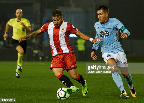 Cristian Portugues 'Portu' of Girona FC is challenged by Hugo Mallo of Celta de Vigo during the La Liga match between Celta de Vigo and Girona at...