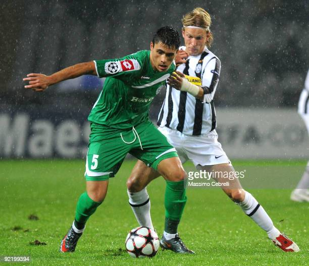 Cristian Poulsen of Juventus FC battles for the ball against Gorge Teixeira of Maccabi Haifa FC during the UEFA Champions League Group A match...