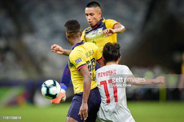 Cristian Ramirez and Jefferson Orejuela of Ecuador fights for the ball with K Miyoshi of Japan during the Copa America Brazil 2019 group C match...
