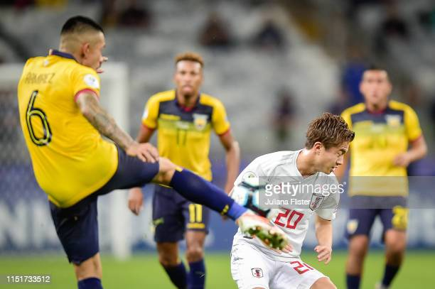 Cristian Ramirez of Ecuador fights for the ball with H Abe of Japan during the Copa America Brazil 2019 group C match between Ecuador and Japan at...