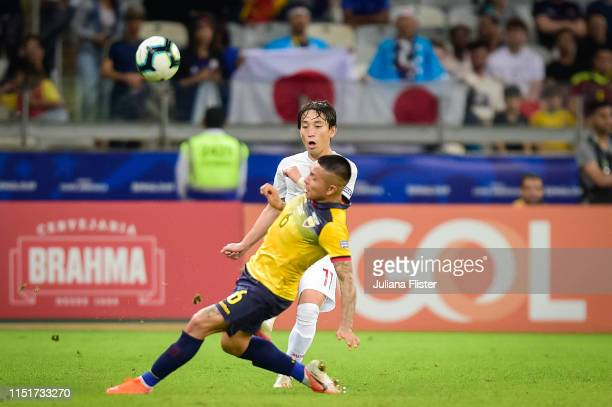 Cristian Ramirez of Ecuador fights for the ball with K Miyoshi of Japan during the Copa America Brazil 2019 group C match between Ecuador and Japan...