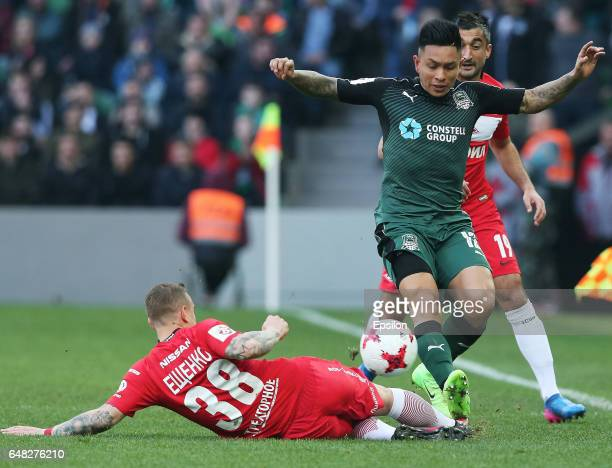 Cristian Ramirez of FC Krasnodar is challenged by Andrey Yeshchenko of FC Spartak Moscow during the Russian Premier League match between FC Krasnodar...