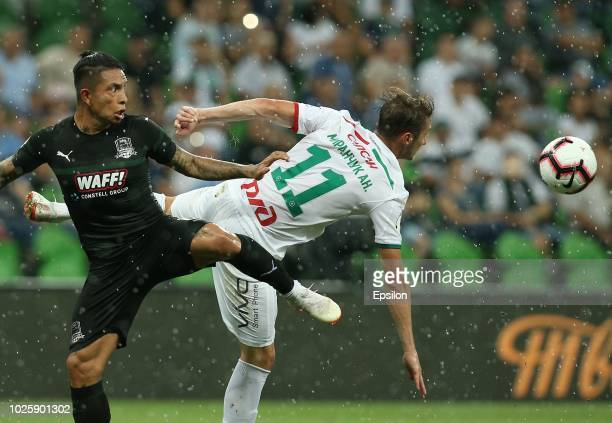 Cristian Ramirez of FC Krasnodar vies for the ball with Anton Miranchuk of FC Lokomotiv Moscow during the Russian Premier League match between FC...