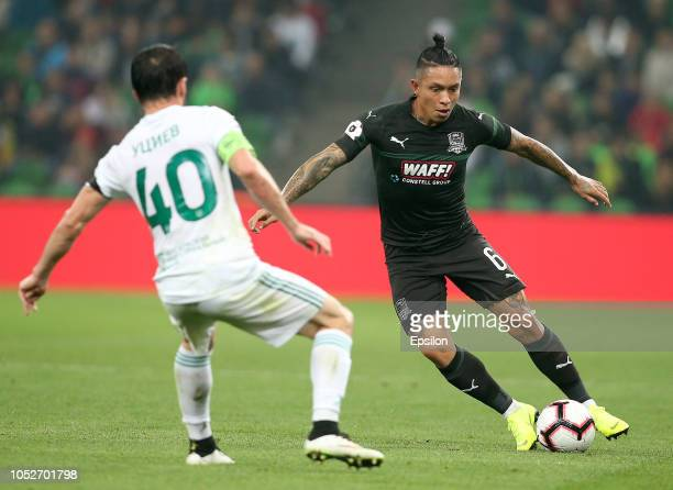 Cristian Ramirez of FC Krasnodar vies for the ball with Rizvan Utsiyev of FC Akhmat Grozny during the Russian Premier League match between FC...