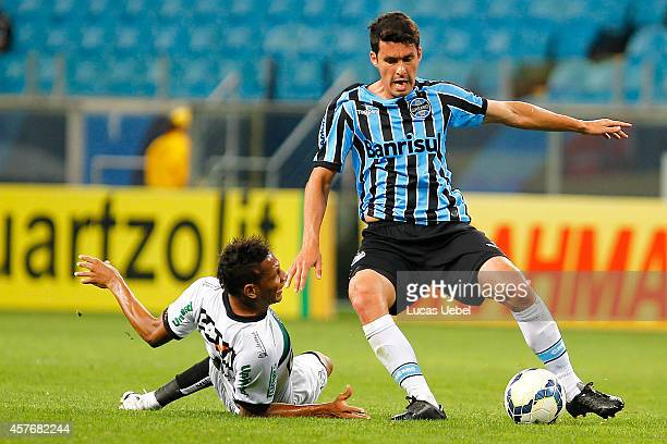 Cristian Riveros of Gremio battles for the ball against Clayton of Figueirense during the match Gremio v Figueirense as part of Brasileirao Series A...