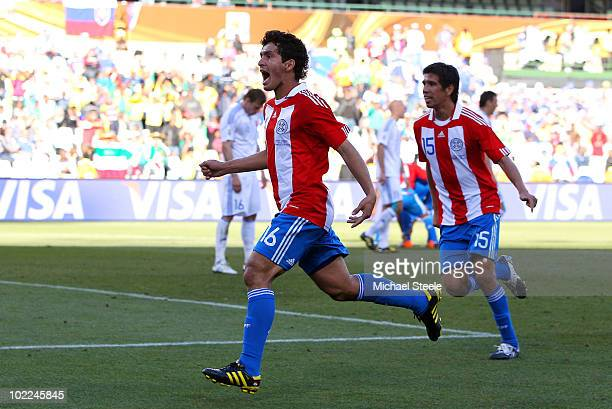 Cristian Riveros of Paraguay celebrates scoring his side's second goal during the 2010 FIFA World Cup South Africa Group F match between Slovakia and...