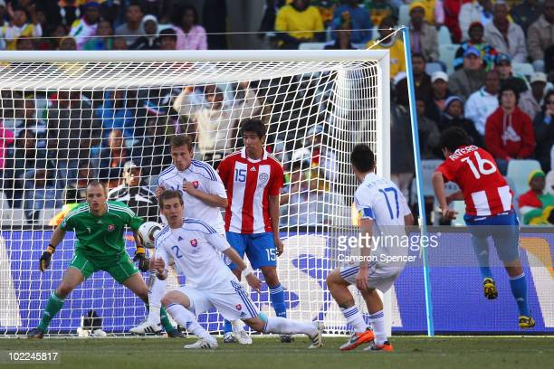 Cristian Riveros of Paraguay scores his side's second goal during the 2010 FIFA World Cup South Africa Group F match between Slovakia and Paraguay at...