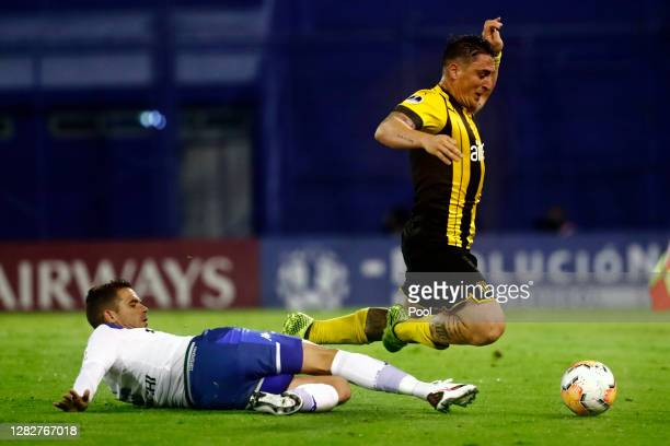 Cristian Rodríguez of Peñarol fights for the ball with Fernando Gago of Velez during a second round match of Copa CONMEBOL Sudamericana 2020 between...
