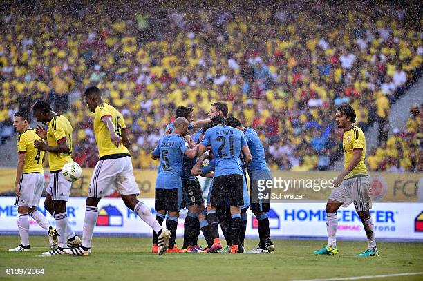 Cristian Rodríguez of Uruguay and teammates celebrate after scoring the opening goal during a match between Colombia and Uruguay as part of FIFA 2018...