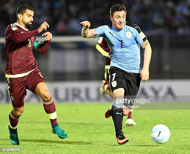 Cristian Rodriguez of Uruguay and Tomas Rincon of Venezuela fight for the ball during a match between Uruguay and Venezuela as part of FIFA 2018...