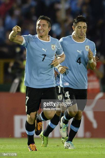 Cristian Rodriguez of Uruguay celebrates a scores goal during a match between Uruguay and Argentina as part of the 18th round of the South American...