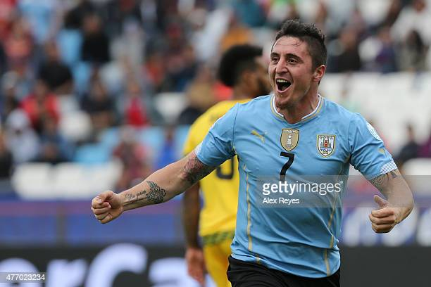 Cristian Rodriguez of Uruguay celebrates after scoring the opening goal during the 2015 Copa America Chile Group B match between Uruguay and Jamaica...