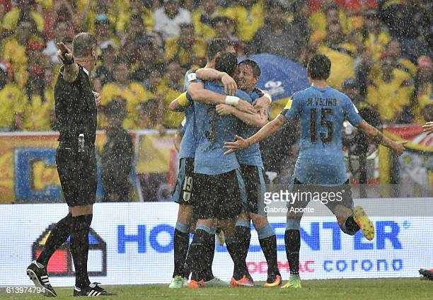 Cristian Rodriguez of Uruguay celebrates with teammates after scoring the first goal of his team during a match between Colombia and Uruguay as part...