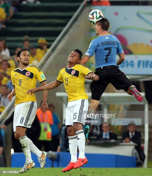 Cristian Rodriguez of Uruguay challenges Alexander Mejia of Colombia while Abel Aguilar look on during the 2014 FIFA World Cup Brazil Round of 16...