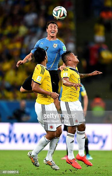 Cristian Rodriguez of Uruguay competes for the ball against Abel Aguilar and Alexander Mejia of Colombia during the 2014 FIFA World Cup Brazil Round...