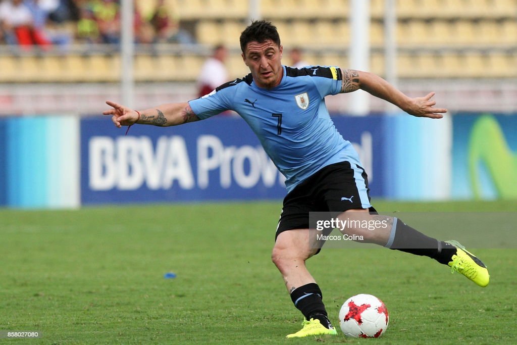 Cristian Rodriguez of Uruguay kicks the ball during a match between Venezuela and Uruguay as part of FIFA 2018 World Cup Qualifiers at Pueblo Nuevo Stadium on October 05, 2017 in San Cristobal, Venezuela.