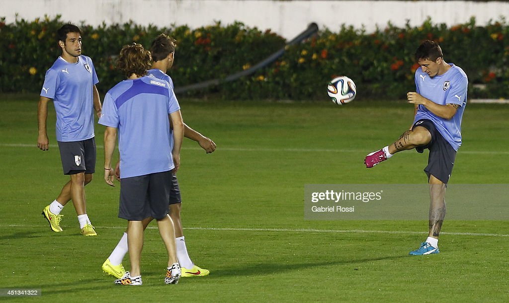 Cristian Rodriguez of Uruguay kicks the ball during a training session as part of the 2014 FIFA World Cup on June 27, 2014 in Rio de Janeiro, Brazil. Uruguay will face Colombia in a Round of 16 match as part of FIFA World Cup 2014 Brazil at Sao Januario Stadium on June 28.
