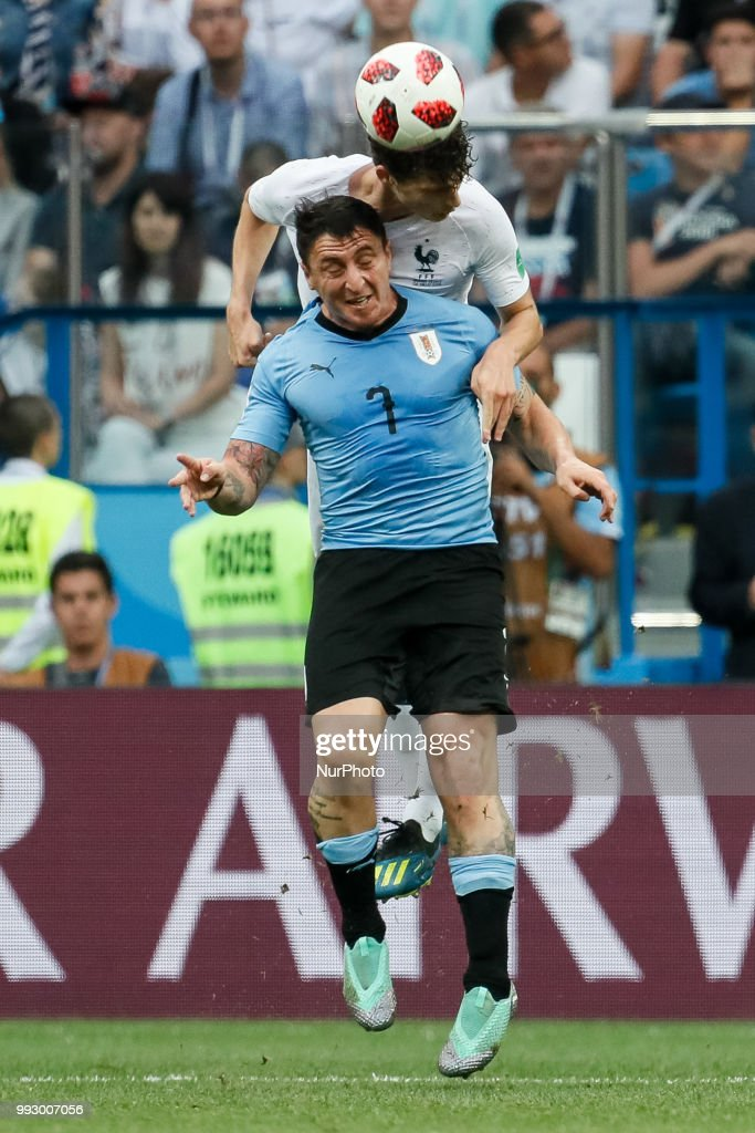 Cristian Rodriguez (in front) of Uruguay national team and Benjamin Pavard of France national team vie for a header during the 2018 FIFA World Cup Russia Quarter Final match between Uruguay and France on July 6, 2018 at Nizhny Novgorod Stadium in Nizhny Novgorod, Russia.