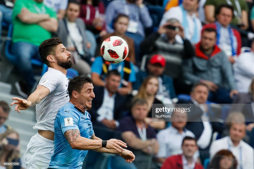 Cristian Rodriguez (R) of Uruguay national team and Olivier Giroud of France national team vie for a header during the 2018 FIFA World Cup Russia Quarter Final match between Uruguay and France on July 6, 2018 at Nizhny Novgorod Stadium in Nizhny Novgorod, Russia.