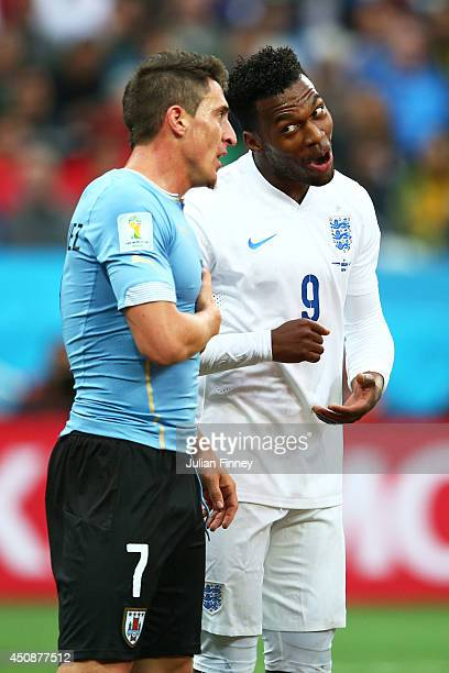 Cristian Rodriguez of Uruguay speaks to Daniel Sturridge of England during the 2014 FIFA World Cup Brazil Group D match between Uruguay and England...